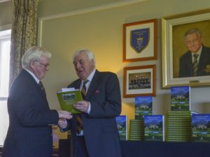3) President Joe Duignan receives a copy of the Powerscourt Golf Club 20th Anniversary Book from John Power – Chairman of the Book Committee.