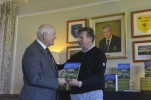 5) Tom Clarke, Director of Powerscourt Estate and retired former General Manager is presented with a copy of the 20th Anniversary Book by Fellow PGA Golf Professional Paul Thompson. Tom has worked for Powerscourt Estate for over 50 years.