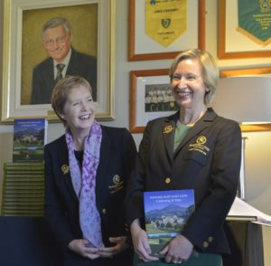 7) 20th Anniversary Lady Captain Aedamar Dunne receives the Powerscourt Golf Club 20th Anniversary Book from 2017 Lady Captain Christine O'Neill.